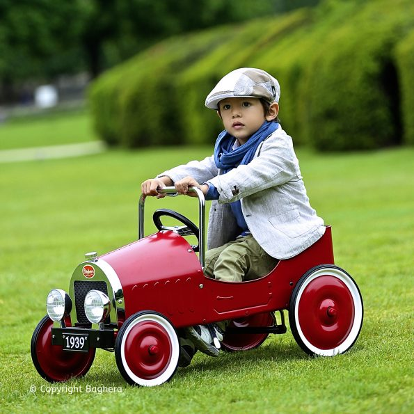 Classic Red Pedal Car with boy